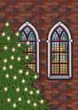 Gammal tegelstenkyrka med julträdet Royaltyfri Foto