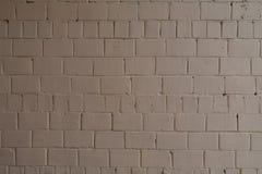 Gammal tegelstentegelstenvägg som målas med brun målarfärg för textur och bakgrund Royaltyfri Fotografi
