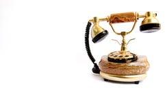 gammal telefon för guld arkivbilder