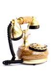 gammal telefon för guld royaltyfri fotografi