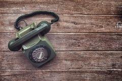 Gammal telefon för tappning Arkivbild