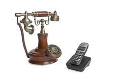 Gammal telefon och sladdlös telefon Royaltyfria Bilder