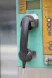 Gammal telefonhörlurar med mikrofon Fotografering för Bildbyråer