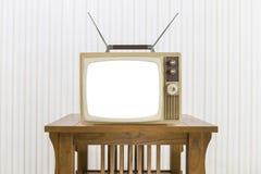 Gammal television med antennen på den Wood tabellen med för snitt skärmen ut Royaltyfri Bild