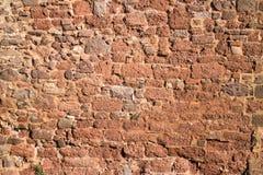 Gammal textur för brostenvägg Arkivbild