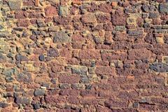Gammal textur för brostenvägg Arkivfoto