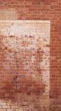Gammal texturerad riden ut målad tegelstenvägg Arkivbilder