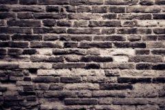 gammal texturerad tappningvägg för tegelsten Arkivbilder