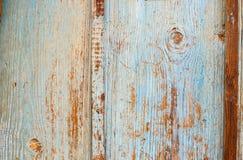 Gammal träbakgrund med blå krusig målarfärg Wood textur för tappning royaltyfri foto