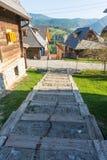 Gammal träetapp i Drvengrad, Serbien Fotografering för Bildbyråer