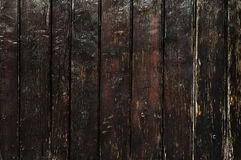 Gammal trästaketbakgrund för mörk brunt royaltyfria foton