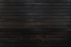 Gammal trästaketbakgrund för mörk brunt fotografering för bildbyråer