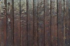Gammal trästaketbakgrund för mörk brunt royaltyfri foto
