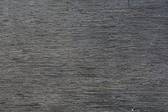 Gammal trävägg i direkt hårt solljus arkivfoto