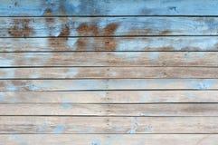 Gammal trävägg målad blå bakgrund Royaltyfri Foto