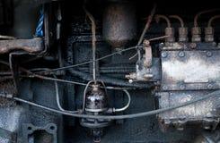 Gammal traktormotor Arkivfoto