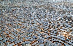 Gammal trottoar från kulöra stenar abstrakt bakgrundstextur Royaltyfri Bild