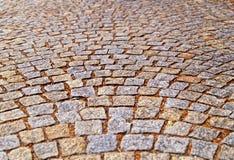 Gammal trottoar från kulöra stenar abstrakt bakgrundstextur Fotografering för Bildbyråer