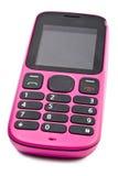 Gammal tryckknapprosa färgtelefon Arkivbild