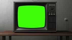 Gammal TV med en grön skärm i rummet