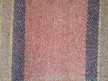 Gammal tygtrådbakgrund /fabric stycke arkivbild