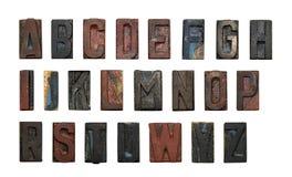 gammal typ trä för alfabet Arkivfoton