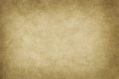 Gammal urblekt pappers- bakgrund Arkivfoto
