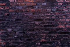 Gammal vägg av röda briks, bakgrund arkivfoton