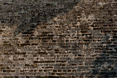 Gammal vägg av svarta briks, bakgrund Royaltyfria Foton
