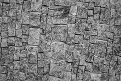 Gammal vägg av texturerade stentegelstenar Royaltyfri Foto