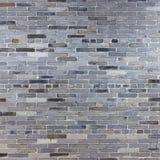 Gammal vägg för grå färgstentegelsten Royaltyfri Fotografi
