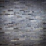 Gammal vägg för grå färgstentegelsten Royaltyfria Foton