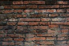 Gammal vägg för röd tegelsten av den forntida staden Arkivbild