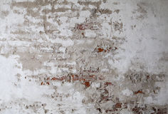 Gammal vägg för röd tegelsten med sprucken konkret bakgrundstextur Arkivbilder