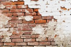 gammal vägg för tegelsten Arkivfoton