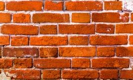 Gammal vägg som göras av röd tegelsten Bakgrund av gamla tegelstenar Århundrade-gammal tegelsten Tegelstenväggen är gammal Fotografering för Bildbyråer