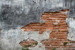 Gammal väggtegelsten knäcker retro bakgrund för konst Royaltyfri Foto