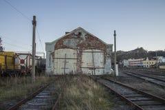 Gammal vagnstall på den Halden stationen Fotografering för Bildbyråer