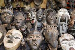 gammala afrikanska maskeringar Fotografering för Bildbyråer