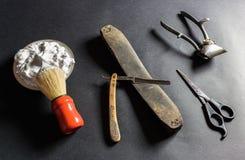Gammala barberarehjälpmedel Arkivfoton