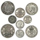 gammala brittiska mynt Arkivfoto