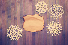 Gammala dekorativa snowflakes Arkivfoton