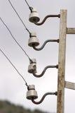 gammala elektriska isolatorer royaltyfri foto