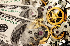 Gammala klockamekanism och dollar Royaltyfria Bilder
