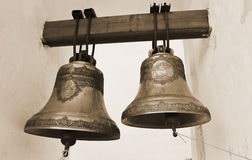 Gammala kyrkliga klockor. Sepia. Royaltyfria Foton