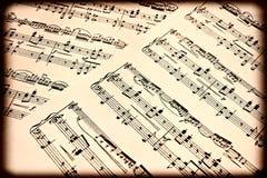 gammala musikaliska anmärkningar Arkivbilder