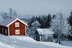 Gammala röda trästugor Fotografering för Bildbyråer