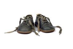 gammala skor för barn Arkivbilder
