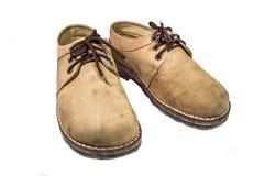 gammala skor för läder Arkivfoton