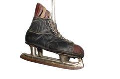 gammala skridskor för hockey Arkivbild